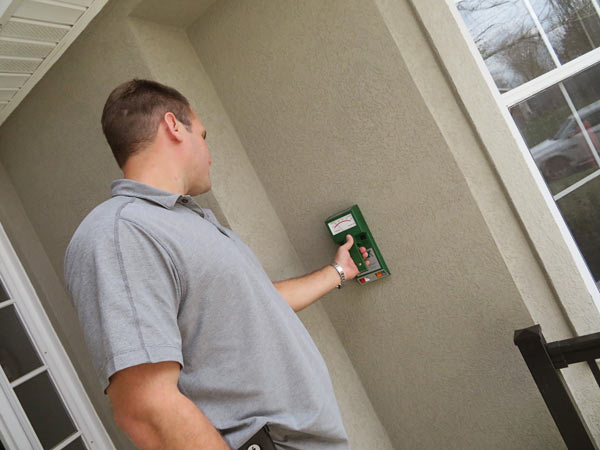 Tramex EIFS moisture meter in use on exterior wall