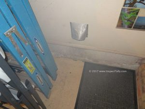 Improper dryer vent termination location noted during a home inspection