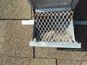 During a roof inspection home inspector noted improper dryer vent cover