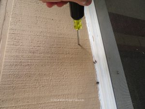 During a home inspection in Tallahassee, an inspectors probe goes through T111 siding, indicating presence of wood rot.