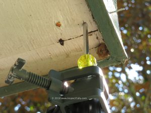 The corner of a wood soffit is a likely spot to find wood rot during a home inspection.