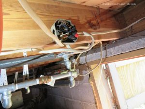 Another view of an overcrowded and improperly secured junction box discovered by a Tallahasee Home Inspector.