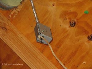 A home Inspector discovered an improperly secured and wired junction box in an attic in Northern Tallahassee.